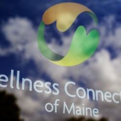 Lettering on the door at the Wellness Connection of Maine, a medical marijuana dispensary with four locations in Maine, marks its Portland office.