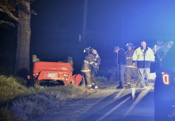 Rescue crews attend to the scene of a crash that sent three people to the hospital with serious injuries in Corinna on Monday night.