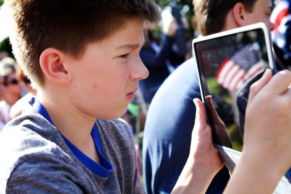 Freeport Middle School student Ben Barry records events at a ceremony Wednesday morning marking the anniversary of Sept. 11, 2001, in Freeport.