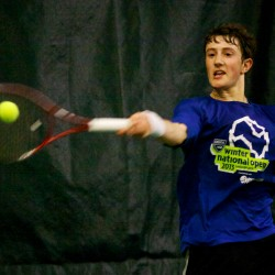 Jordan Friedland of Lincoln Academy returns a volley in the finals match at the Maine Principals Association Singles Tennis Championship at the Racket and Fitness Center in Portland in May.