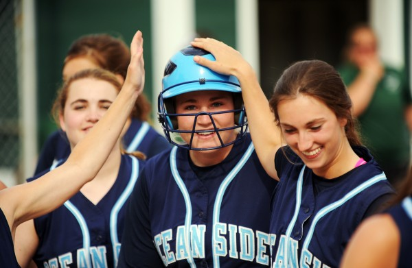 Oceanside's Kennadi Grover celebrates with teammates after hitting a home run in June versus Old Town.
