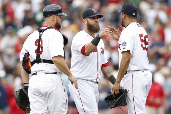 Boston Red Sox catcher David Ross (3), first baseman Mike Napoli (middle) and pitcher Franklin Morales (56) celebrate defeating the New York Yankees 5-1 at Fenway Park. Saturday in Boston.