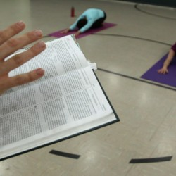 Jonnie Goodmanson reads passages during her Holy Yoga class in Robbinsdale, Minnesota, in May 2011.