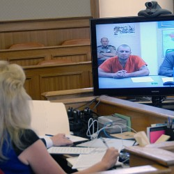 Murder suspect Matthew Davis appears with attorney Jeff Pickering before Justice E. Allen Hunter in Aroostook County Superior Court in Houlton on Wednesday, Sept. 25, 2013.