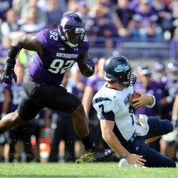 Maine Black Bears quarterback Marcus Wasilewski (7) slides in front of Northwestern Wildcats defensive lineman Will Hampton (92) during the first quarter at Ryan Field in this Sept. 21, 2013 file photo.