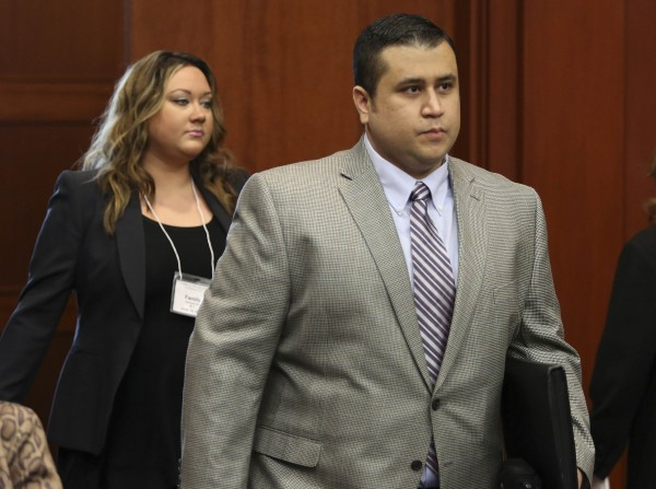 George Zimmerman, followed by his wife Shellie , enters the court room on the fifth day of jury selection in his murder trial for shooting death of Trayvon Martin in 2012, at Seminole circuit court in Sanford, Florida, in this June 14, 2013 file photo.
