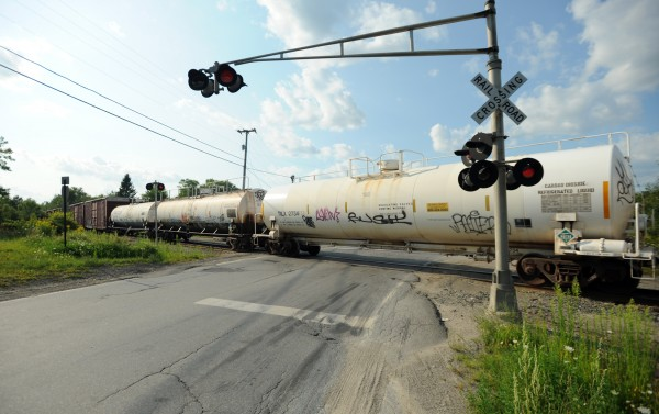 Coldbrook Road in Hermon is blocked by a tanker car as Pan Am Railways officials tend to a derailment along a section of track close by.
