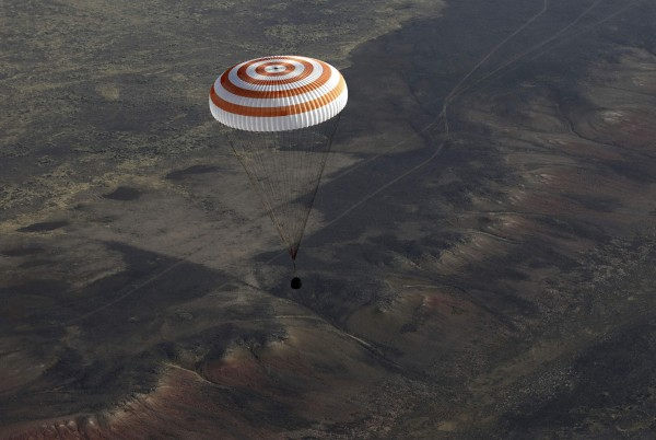 A Russian Soyuz TMA-08M spacecraft carrying Expedition 36 Commander Russian cosmonaut Pavel Vinogradov and Flight Engineers, NASA astronaut Chris Cassidy and Russian cosmonaut Alexander Misurkin descends beneath a parachute just before landing  some 146 km southeast of the town of Zhezkazgan in Kazakhstan, Sept. 11, 2013.
