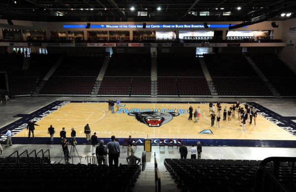 The University of Maine's men's and women's basketball teams were present Thursday afternoon for the unveiling of the new basketball floor at the Cross Insurance Center in Bangor where they will be playing most of their home games.