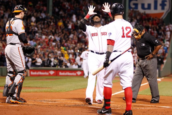 Boston Red Sox designated hitter David Ortiz (34) hits a two-run home run against the Baltimore Orioles in the first inning of Wednesday night's game at Fenway Park. The Orioles won 5-3 in 12 innings.