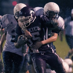 Maine Central Institute's Mitchell Hathaway (35) is tackled by Stearns' Dylan Kruger (4) after a carry in the first half of their game in Pittsfield, Maine, Friday Sept. 13, 2013.