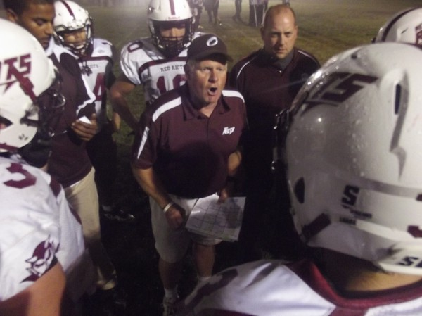 Orono head football coach Bob Sinclair exhorts his team during a timeout in first-half action at Washington Academy in East Machias Friday night.