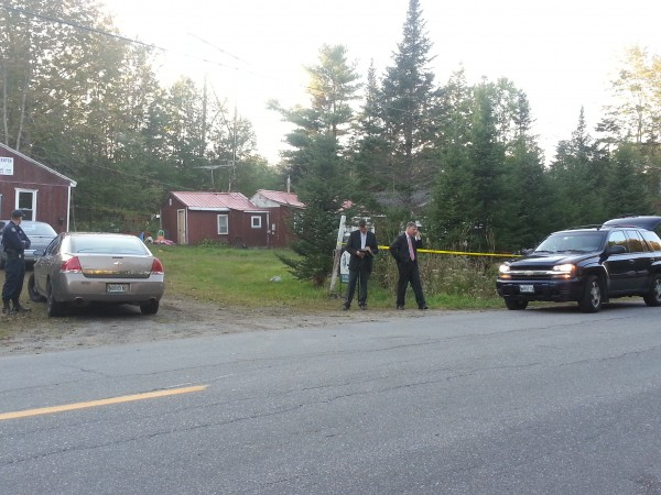 Law enforcement officials work outside the home on New England Road in Searsmont where a Maine State Police trooper shot a man Friday afternoon. The injured man, 42-year-old Leonard Maker, was in surgery later Friday for what police described as injuries that were not life-threatening.