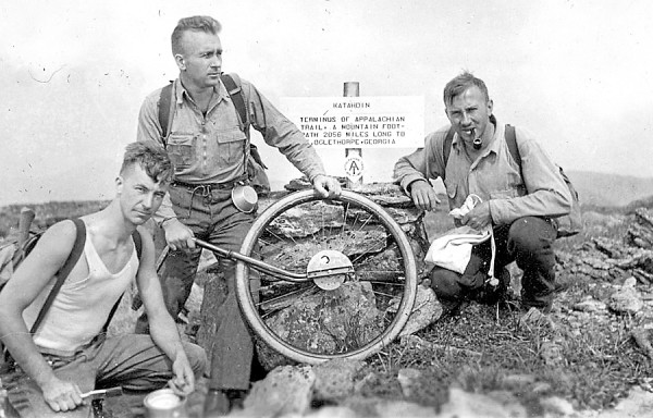 "In this photograph, taken Aug. 19, 1933, as it appeared in the book ""Along Maine's Appalachian Trail"" by trail historian and Maine Appalachian Trail Club member Dave Field of Hampden, are (from left) Albert H. Jackman with paint can, Myron H. Avery holding a wheel for measuring distance and J. Frank Schairer, who pose in front of the original AT summit sign on Baxter Peak. The photo was taken the day the team, including Shailer Philbrick, who took the photo, started south to mark the Maine leg of the AT. Avery, a lawyer who grew up in Lubec and worked in Washington, D.C., was the driving force behind the establishment of the AT in Maine and the founder of the Maine Appalachian Trail Club. The other three men were geologists."