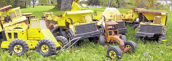Joe Plummer of Searsport is coordinating the Tonka Truck Restoration Project so children can take part in getting damaged toy trucks, such as these, repaired.