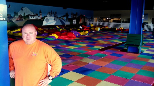 Ryan Hatch, the owner of The Maine Jump in Bangor, stands in his facility before it opens July 17, 2013. According to Hatch, decline in attendance may cause the Maine Jump to shutdown Nov. 1.