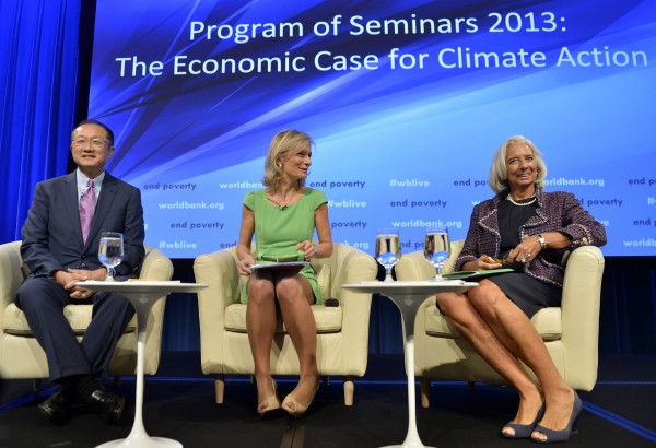 World Bank President Jim Yong Kim (left) and IMF Managing Director Christine LaGarde (right) join The Economist Economics Editor Zanny Minton-Beddoes for a panel discussion of &quotThe Economic Case for Climate Action&quot as part of the IMF and World Bank's 2013 Annual Fall Meetings, an gathering of the world's finance ministers and bank governors, in Washington, October 8, 2013.