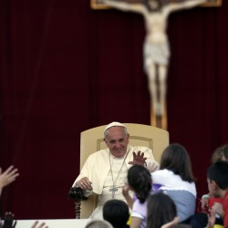 Pope Francis waves as he leads a special audience with families at the St Peter Square in Vatican October 26, 2013.