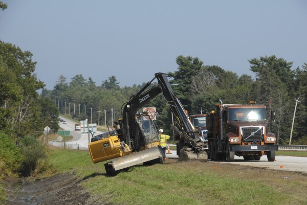 Maine Department of Transportation workers clear a ditch along the southbound lane of Route 202 in Hampden in Spetember. The MDOT has also replaced culverts along a section of nearby Coldbrook Road.