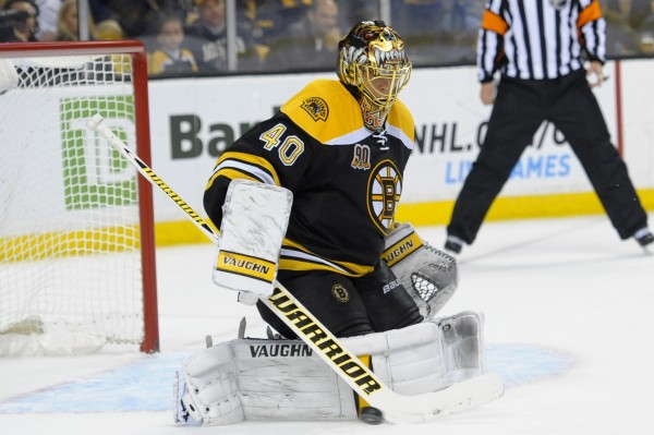 Boston Bruins goalie Tuukka Rask (40) makes a save during the third period against the New Jersey Devils at TD Banknorth Garden in Boston Saturday night.