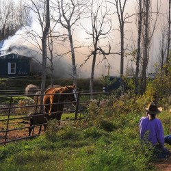 Home owner Raydell Henderson (left) and his daughter Katelynn Henderson watch helplessly as their home burns on Sawyer Road in Levant.
