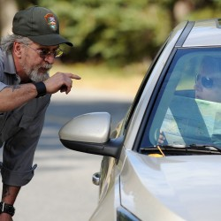 Acadia National Park heavy equipment mechanic Ray Sanborn offers directions to a tourist who wanted to see as much of Acadia as possible despite the federal government shutdown and the closure of the park on Tuesday.