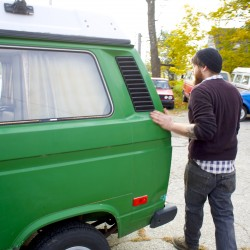 Ian Pottle places his hand on a 1984 Volkswagen Westfalia while giving a tour of The Beetle Shop in Belfast that focuses on repairing Volkswagens especially VW buses and camper vans. The shop has been open since 1977 and was recently handed down to Pottle by his father Allen Pottle.
