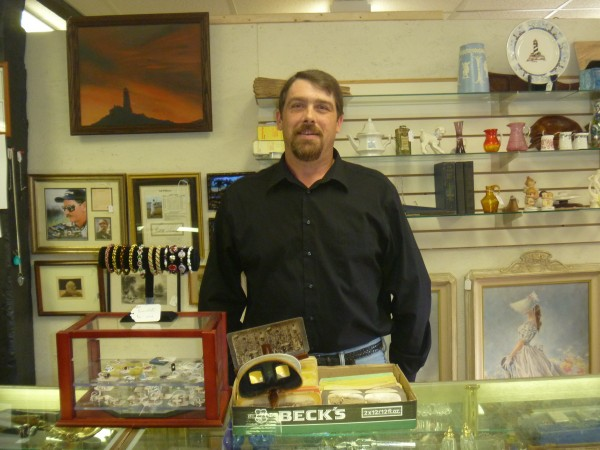Arthur Carlow stands behind the counter, ready for business at the Hampden Antiques Mall, 281 Western Ave. in Hampden. Carlow, owner of the mall, opened the store on Sept. 4.