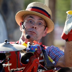"""Rick Adam, also known as Professor Paddy-Whack, sings for a crowd at the Fryeburg Fair Tuesday. """"This is my 27th year at the fair,"""" said Adam."""