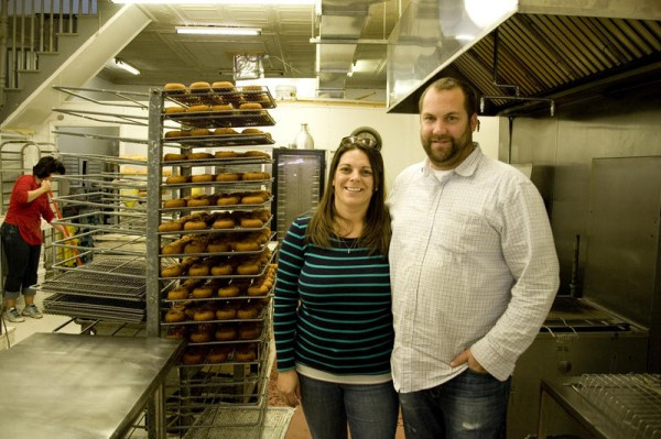 Frosty's Donuts owners Shelby St. Pierre and Nels Omdal stand in their Maine Street, Brunswick, kitchen, which will be expanded to accommodate the business' growth into new markets.