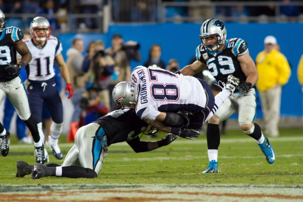Nov 18, 2013; Charlotte, NC, USA; Carolina Panthers strong safety Robert Lester (38) tackles New England Patriots tight end Rob Gronkowski (87) during the fourth quarter at Bank of America Stadium. The Panthers defeated the Patriots 24-20.