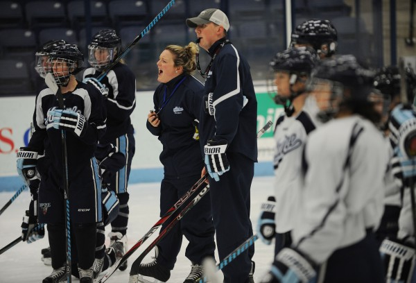 University of Maine women's hockey coaches Sara Simard Reichenbach and Richard Reichenbach give out instructions to their team during a practice Tuesday at Alfond Arena. The Reichenbachs are the interim coaches of the University of Maine women's hockey team and are also husband and wife, who were married on Oct. 14.