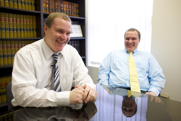 Nick (left) and Ben Fowler are identical twins and both practice law in Bangor.