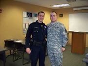 Bangor police Officer Nick Huggins and his brother, Chris Huggins, a PFC in the U.S. Army, share a moment at the Bangor police station Wednesday morning. Chris Huggins, who had been stationed in South Korea for over a year, surprised his brother with an early Thanksgiving homecoming.