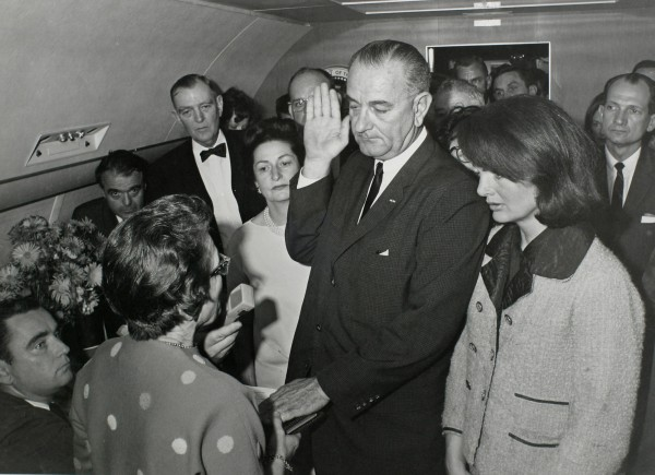 Vice President Lyndon Baines Johnson takes the presidential oath of office from Judge Sarah T. Hughes as President John F. Kennedy's widow, first lady Jacqueline Bouvier Kennedy, stands at his side aboard Air Force One at Love Field in Dallas, Texas, just two hours after Kennedy was shot on Nov. 22, 1963.