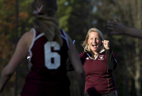 Foxcroft Academy coach Stephanie Smith congratulates Emma Tetlow after defeating North Yarmouth Academy in the Class C field hockey state championship game Saturday.