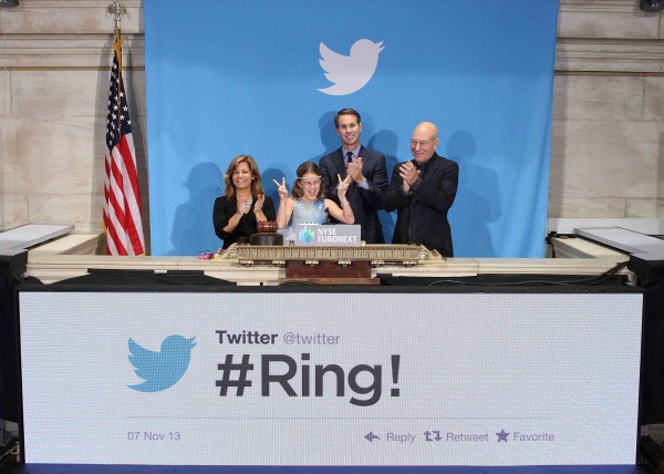 Actor Patrick Stewart, Twitter co-founder Evan Williams, 9-year-old Vivienne Harr and Cheryl Fiandaca of the Boston Police Department ring the opening bell at the New York Stock Exchange in New York November 7, 2013.