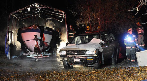 Firefighters work to douse a garage fire at 419 Spring Water Road in Poland on Wednesday evening.