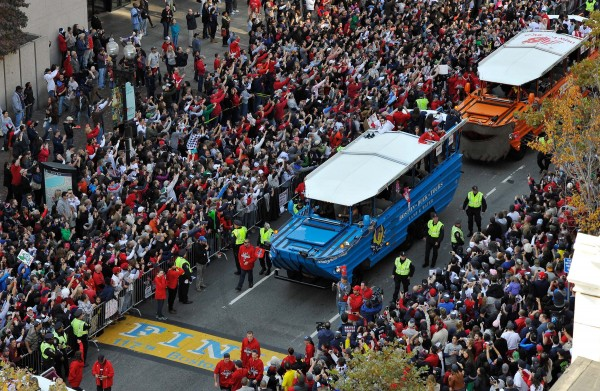 An overhead view as duck boats carry Boston Red Sox players across the marathon finish line during the World Series parade as seen from Old South Church in Copley Square.