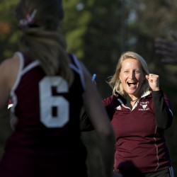 Foxcroft Academy coach Stephanie Smith congratulates Emma Tetlow after defeating North Yarmouth Academy in the Class C field hockey state championship game Saturday, Nov. 2, 2013, in Yarmouth, Maine.