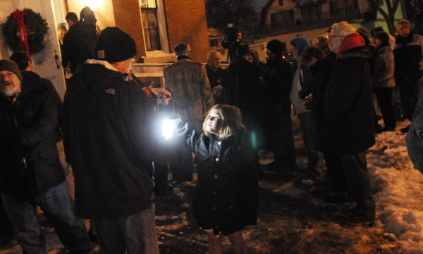 People stand outside the Hammond Street Congregational Church in Saturday's cold before the start of a vigil honoring the homeless people of Bangor who have died during the past year.