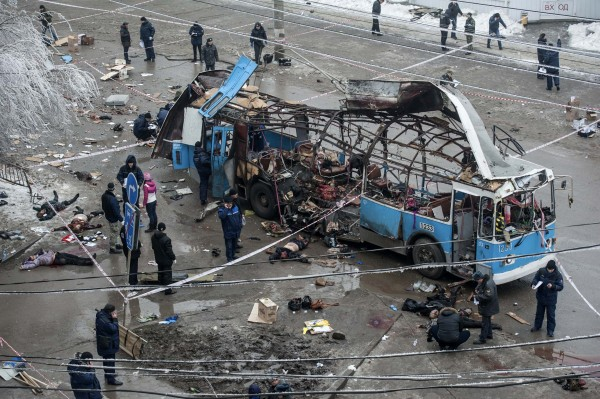 Investigators work at the site of a blast on a trolley in Volgograd, Russia, on Monday. A bomb blast ripped the trolley apart, killing 14 people in the second deadly attack in the southern city in two days and raising fears of further violence as Russia prepares to host the Winter Olympics.