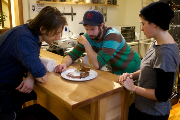 The staff of Vinland, a new restaurant opening this week in Portland that plans on only serving locally sourced food, ponder a dish at the edge of the kitchen Monday. From left are owner chef David Levi and sous chefs Ryan Quigley and Kate Whittemore.