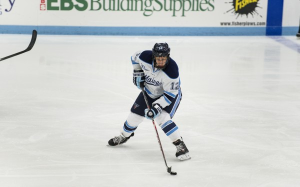 The University of Maine's Bill Norman takes control of the puck during the second period against Dalhousie University at the Alfond Arena in Orono on Oct. 6.