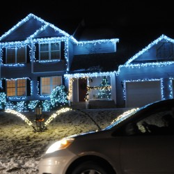 A car passes 21 Hillview Dr., Bangor on Saturday night. Deanna and Rick Hathaway have decorated their house with lights that turn on, fade in and out and shimmer in tune with Christmas music they self-broadcast at 88.1 FM.