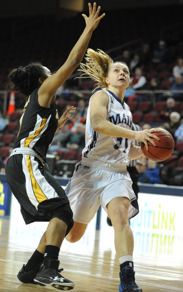 UMaine's Liz Wood makes a lay up against  Towson's Dominique Johnson during first-half action Saturday at Bangor.