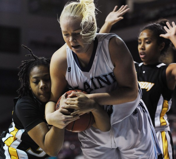 UMaine's Mikaela Gustafsson gets tangled with Towson's Alliyah Berger while chasing a loose ball during first-half action Saturday at the Cross Insurance Center in Bangor.