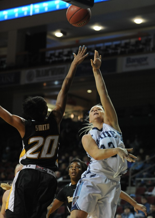 UMaine's Camille Alberson shoots over Towson's Markell Smith during first-half action Saturday at Bangor.