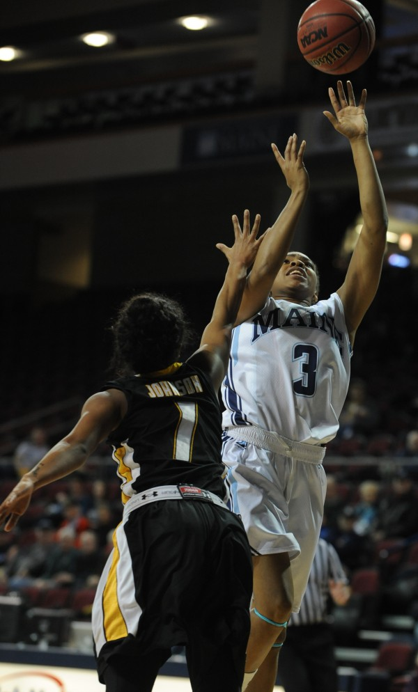 UMaine's Chantel Charles shoots over Towson's Dominique Johnson during first-half action Saturday at Bangor.