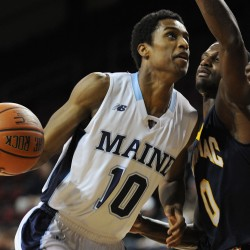UMaine's Shaun Lawton goes to the hoop against Quinnipiac's Umar Shannon last month at the Cross Insurance Center in Bangor.